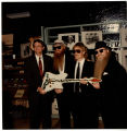 "ZZ Top presenting ""Muddywood"" guitar to Sid Graves"