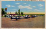 Postcard of cadets taking off for instruction flight in training planes at the Columbus Army...
