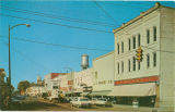 Postcard of Columbus, Mississippi, Showing a section of downtown Columbus on Fifth Street South,...