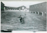 Three Camp Van Dorn Soldiers Playing Ball