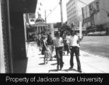 Photograph of Millsaps College students marching down Capitol Street; [May 1970]