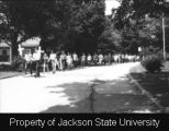 Photograph of Millsaps College students marching; [May 1970]