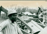 Tornado damage 1976: DeSoto Plant employee observing