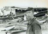 Tornado damage 1976: Mr. Neil Holden surveying Desoto Manufacturing Plant