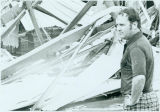 Tornado damage 1976: B. J. Burgess, general manager of DeSoto Manufacturing Plant surveys tornado...