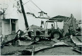 Tornado damage 1976: Bulldozing debris from streets