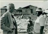 Tornado damage 1976: Sonny Montgomery surveys tornado damage with Levi Jackson