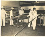 Men in PW uniforms baking bread; circa 1940-1945