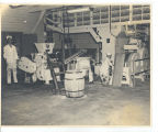 Men in PW uniforms working with machinery; circa 1940-1945