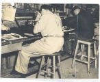 Men in PW uniforms working in a shop; circa 1940-1945